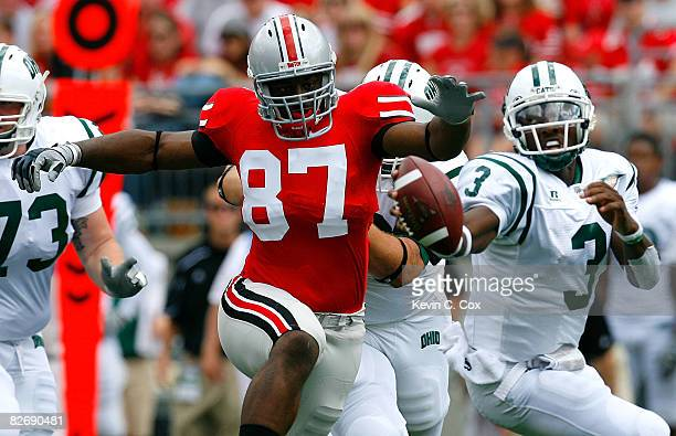 Defensive lineman Lawrence Wilson of the Ohio State Buckeyes gives chase to quarterback Theo Scott of the Ohio Bobcats during the game at Ohio...