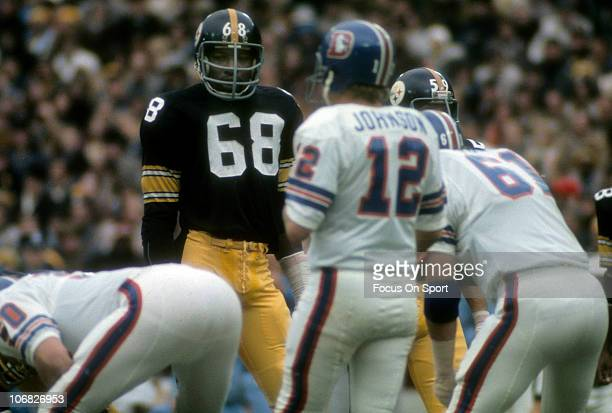 Defensive lineman LC Greenwood of the Pittsburgh Steelers watches Denver Broncos quarterback Charlie Johnson come to the line of scrimmage during an...