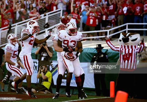 Defensive lineman Louis Nzegwu of the Wisconsin Badgers returns a fumble by Darron Thomas of the Oregon Ducks for a 33yards and a touchdown in the...