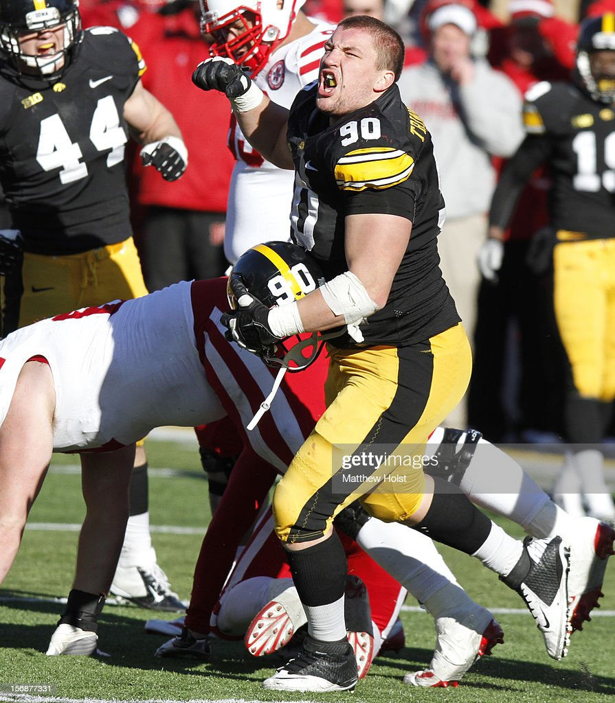 Defensive lineman Louis Trinca-Pasat #90 of the Iowa Hawkeyes celebrates during the fourth quarter after sacking quarterback Taylor Martinez #3 of the Nebraska Cornhuskers on November 23, 2012 at Kinnick Stadium in Iowa City, Iowa. Nebraska defeated Iowa 13-7.