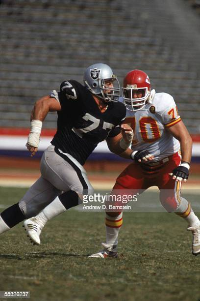 Defensive lineman Lyle Alzado of the Los Angeles Raiders runs on the field during a game circa 19821985 against the Kansas City Chiefs at Memorial...