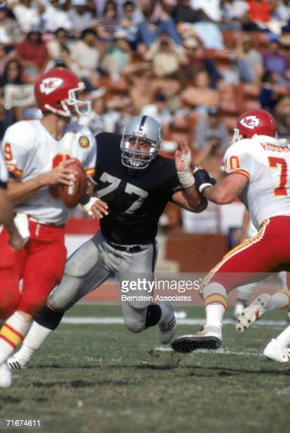 Defensive lineman Lyle Alzado of the Los Angeles Raiders rushes the quarterback of the Kansas City Chiefs during a season game Lyle Alzado played for...