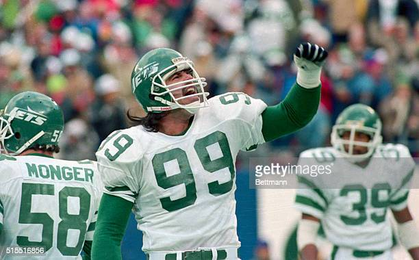 Defensive lineman Mark Gastineau for the New York Jets tackles the offense