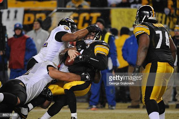 Defensive lineman Marques Douglas of the Baltimore Ravens sacks linebacker Ben Roethlisberger of the Pittsburgh Steelers with help from linebacker...