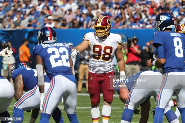 Defensive Lineman Matt Ioannidis of the Washington Redskins gets set at the line against the New York Giants in the first half at MetLife Stadium on...