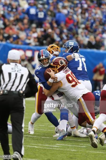Defensive Lineman Matt Ioannidis of the Washington Redskins sacks quarterback Eli Manning of the New York Giants during their game at MetLife Stadium...