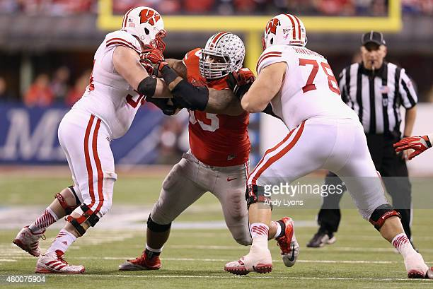 Defensive lineman Michael Bennett plays while wearing to honor late teammate Kosta Karageorge of the Ohio State Buckeyes during the Big Ten...