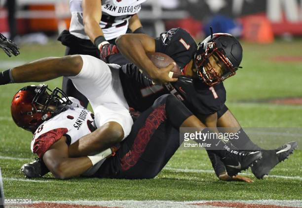 Defensive lineman Myles Cheatum of the San Diego State Aztecs sacks quarterback Armani Rogers of the UNLV Rebels during their game at Sam Boyd...