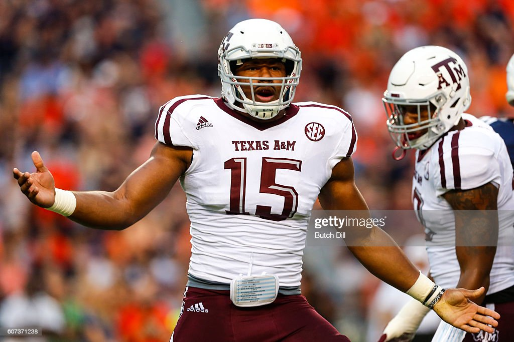 Defensive lineman Myles Garrett #15 of the Texas A&M Aggies celebrates after sacking quarterback Sean White of the Auburn Tigers during an NCAA college football game on September 17, 2016 in Auburn, Alabama.