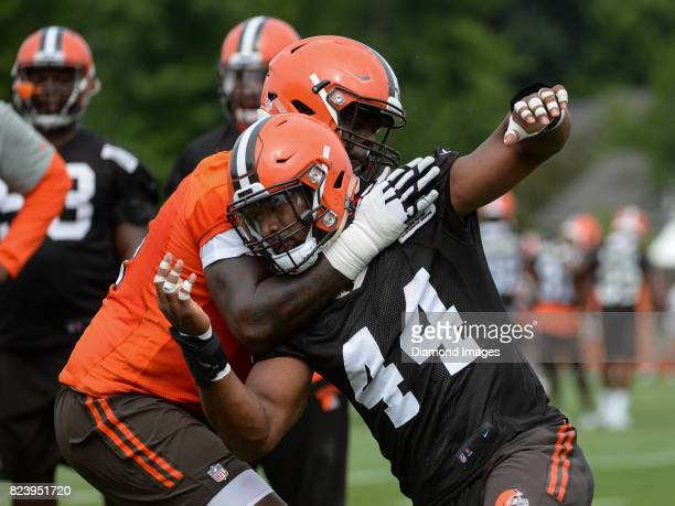 Defensive lineman Nate Orchard and offensive lineman Cameron Erving of the Cleveland Browns engage during a training camp practice on July 27, 2017...