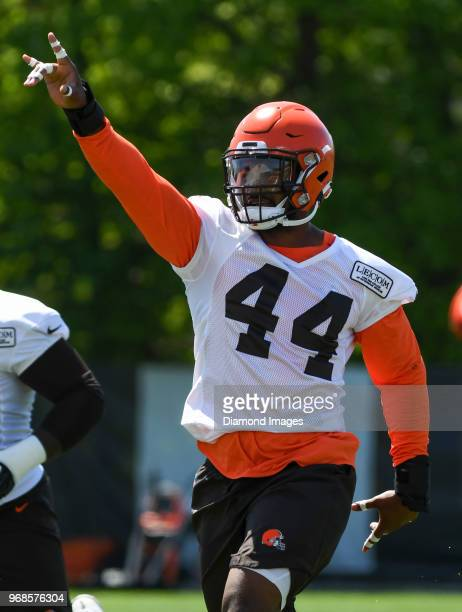 Defensive lineman Nate Orchard of the Cleveland Browns gestures toward the sideline as he stretches during an OTA practice at the Cleveland Browns...
