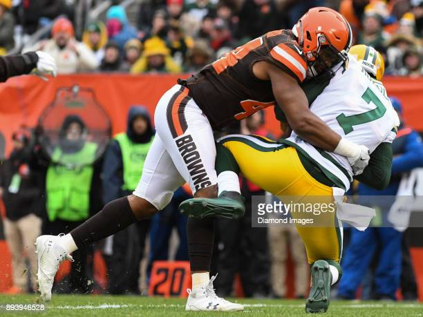 Defensive lineman Nate Orchard of the Cleveland Browns sacks quarterback Brett Hundley of the Green Bay Packers in the first quarter of a game on...