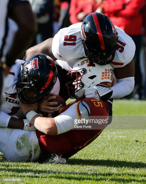 Defensive lineman Nelson Mbanasor and linebacker Jordyn Brooks of the Texas Tech Red Raiders sack quarterback Brock Purdy of the Iowa State Cyclones...