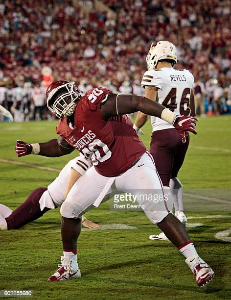 Defensive lineman Neville Gallimore of the Oklahoma Sooners celebrates a fumble recovery during the game against the Louisiana Monroe Warhawks...