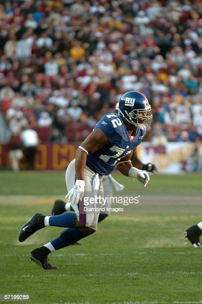 Defensive lineman Osi Umenyiora of the New York Giants during a game on December 24 2005 against the Washington Redskins at Fedex Field in Landover...