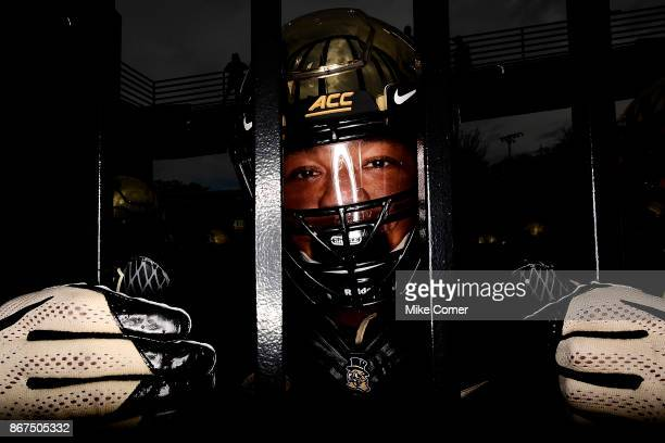 Defensive lineman Paris Black of the Wake Forest Demon Deacons waits behind the entrance gate to the field before the Deacons' football game against...
