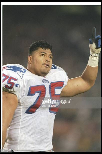 Defensive lineman Pio Sagapolutele of the New England Patriots celebrates during a game against the San Diego Chargers at Jack Murphy Stadium in San...
