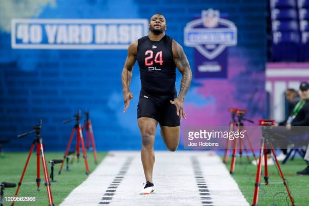 Defensive lineman Raekwon Davis of Alabama runs the 40-yard dash during the NFL Combine at Lucas Oil Stadium on February 29, 2020 in Indianapolis,...