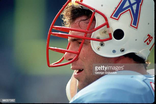 Defensive lineman Ray Childress of the Houston Oilers appears to have a tear running down his cheek while on the sideline during a game against the...