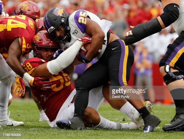 Defensive lineman Ray Lima of the Iowa State Cyclones tackles running back Trevor Allen of the Northern Iowa Panthers as he rushed for yards in the...