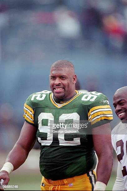 Defensive lineman Reggie White of the Green Bay Packers on the field after a game against the Cleveland Browns at Municipal Stadium on November 19...