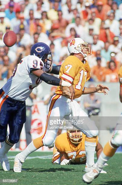 Defensive lineman Richard Dent of the Chicago Bears strips the ball from quarterback Steve DeBerg of the Tampa Bay Buccaneers during the game at...