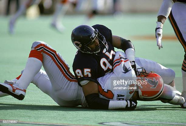 Defensive lineman Richard Dent of the Chicago Bears tackles quarterback David Archer of the Atlanta Falcons during the game at Soldier Field on...