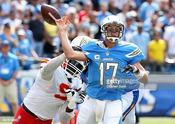 Defensive lineman Tamba Hall of the Kansas City Chiefs forces a fumble by quarterback Philip Rivers of the San Diego Chargers in thesecond quarter at...
