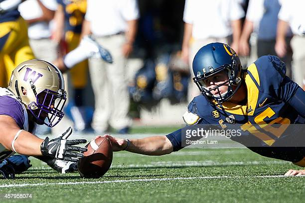 Defensive lineman Taniela Tupou of the Washington Huskies rushes to recover a fumble by quarterback Jared Goff of the California Golden Bears during...