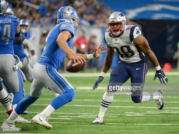 Defensive lineman Trey Flowers of the New England Patriots pursues quarterback Matthew Stafford of the Detroit Lions in the second quarter of a...