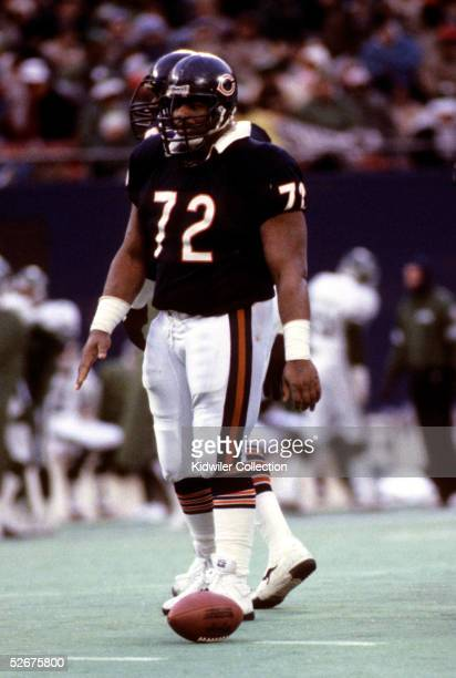 Defensive lineman William The Refrigerator Perry of the Chicago Bears lines up for the next play during a game on December 14 1985 against the New...