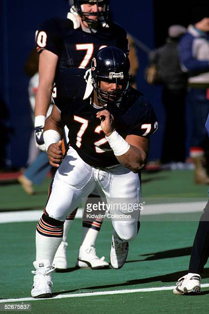 Defensive lineman William The Refrigerator Perry of the Chicago Bears runs through drills prior to a game on December 14 1985 against the New York...