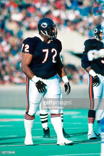 Defensive lineman William 'The Refrigerator' Perry of the Chicago Bears lines up for a play during a game on November 22 1987 against the Detroit...