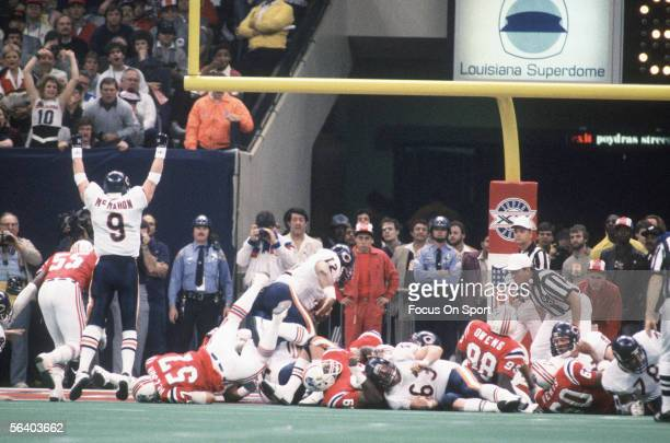 Defensive Lineman William The Refrigerator Perry of the Chicago Bears rushes for a one yard touchdown in the third quarter as quarterback Jim McMahon...