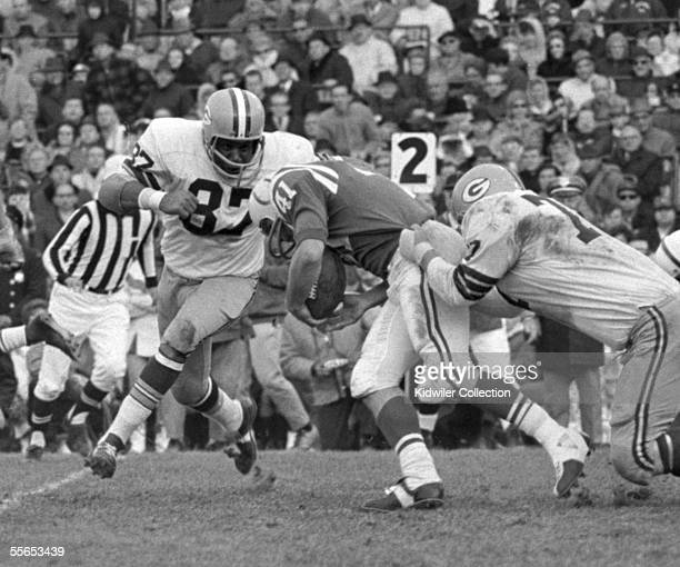 Defensive lineman Willie Davis of the Green Bay Packers tries to stop runningback Tom Matte of the Baltimore Colts during a game on November 5 1967...