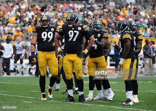 Defensive linemen Brett Keisel and Cameron Heyward and linebackers Lawrence Timmons Jason Worilds and Sean Spence of the Pittsburgh Steelers look on...