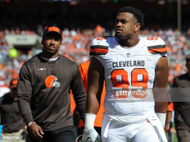 Defensive linemen Caleb Brantley and Myles Garrett of the Cleveland Browns walk off the field for halftime of a game on October 1 2017 against the...