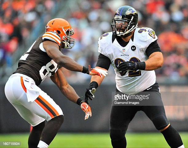 Defensive linemen Haloti Ngata of the Baltimore Ravens puts a pass rush move on tight end Benjamin Watson of the Cleveland Browns during a game...