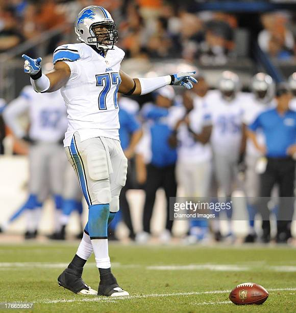 Defensive linemen Isreal Idonije of the Detroit Lions waits to get lined up before the snap of the football during a game against the Cleveland...