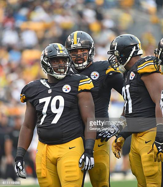Defensive linemen Javon Hargrave, Cameron Heyward and Stephon Tuitt of the Pittsburgh Steelers look on from the field during a game against the...
