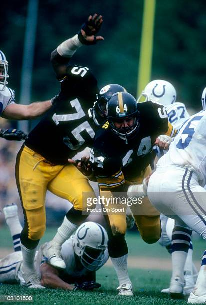 Defensive linemen Joe Greene and Steve Furness of the Pittsburgh Steelers pursue the play against Baltimore Colts circa 1977 during an NFL football...