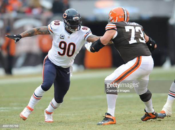 Defensive linemen Julius Peppers of the Chicago Bears rushes the quarterback while being blocked by offensive linemen Joe Thomas of the Cleveland...