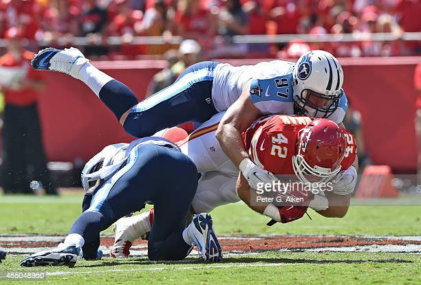 Defensive linemen Karl Klug of the Tennessee Titans tackles running back Anthony Sherman of the Kansas City Chiefs during the first half on September...