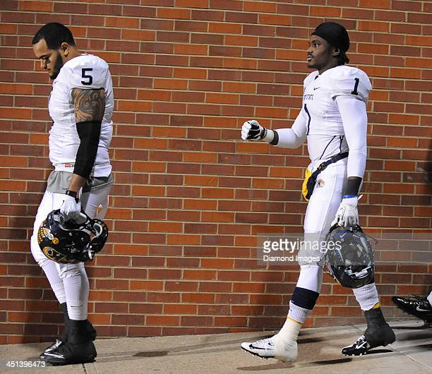 Defensive linemen Roosevelt Nix and running back Dri Archer of the Kent State Golden Flashes walks to the field before a game against the Ohio...