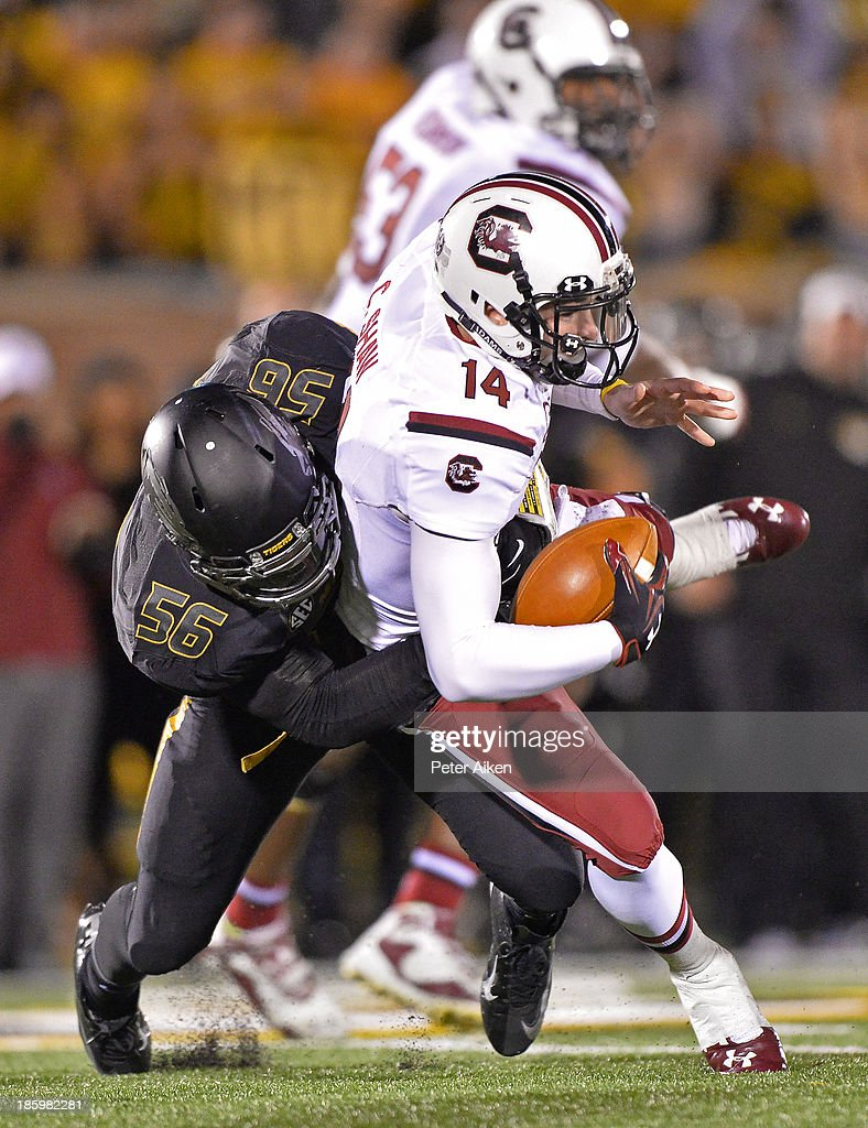 Defensive linemen Shane Ray #56 of the Missouri Tigers sacks quarterback Connor Shaw #14 of the South Carolina Gamecocks during the second half on October 26, 2013 at Faurot Field/Memorial Stadium in Columbia, Missouri. South Carolina defeated Missouri in double overtime 27-24.