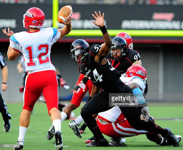 Defensive linemen Walter Stewart of the Cincinnati Bearcats ruches the passer during a game with the Delaware State Hornets at Nippert Stadium in...