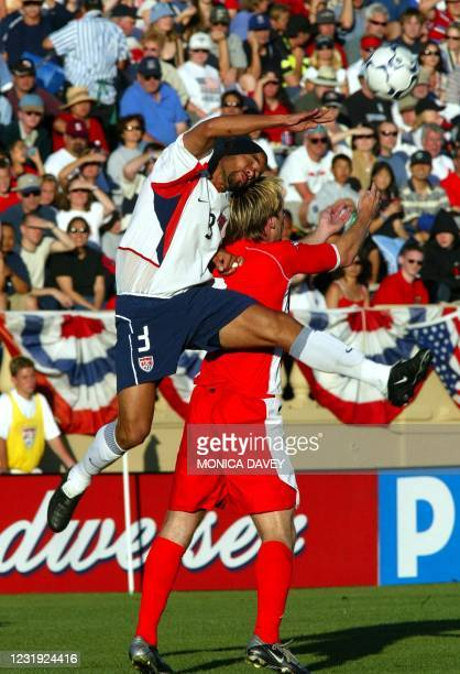 Defensive player C.J Brown heads the ball against Wales forward Gareth Taylor during first half action 26 May 2003 in San Jose California. USA lead...