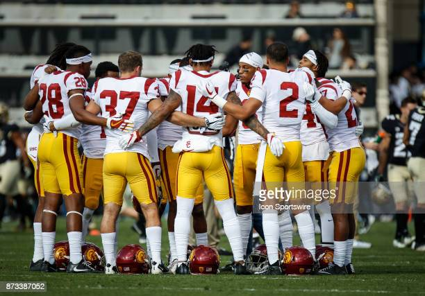 USC defensive players huddle up on the field before the Colorado Buffalos game versus the USC Trojans on November 11 at Folsom Field in Boulder Co...