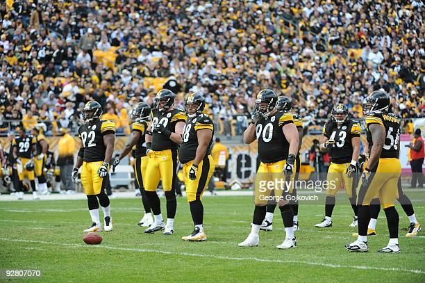 Defensive players James Harrison Brett Keisel Casey Hampton Travis Kirschke Troy Polamalu and LaMarr Woodley of the Pittsburgh Steelers look on from...