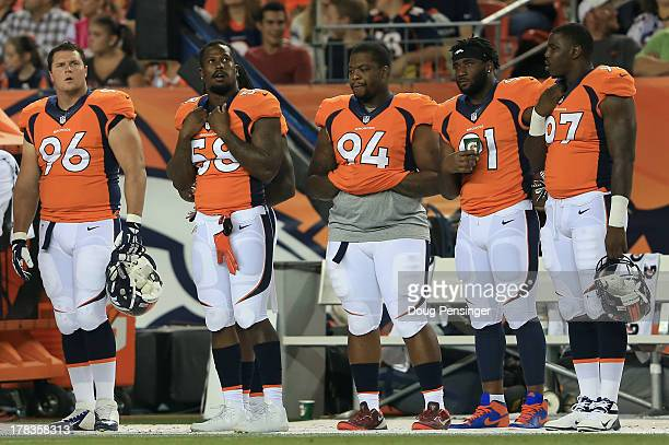 Defensive players Mitch Unrein, outside linebacker Von Miller, defensive tackle Terrance Knighton, defensive end Robert Ayers and defensive end Malik...
